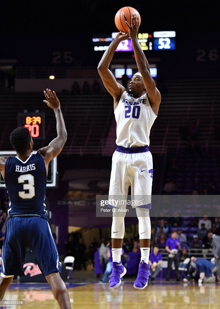 Forward Xavier Sneed #20 of the Kansas State Wildcats put up a shot against guard Jontray Harris #3 of the Oral Roberts Golden Eagles during the second half on November 29, 2017 at Bramlage Coliseum in Manhattan, Kansas.