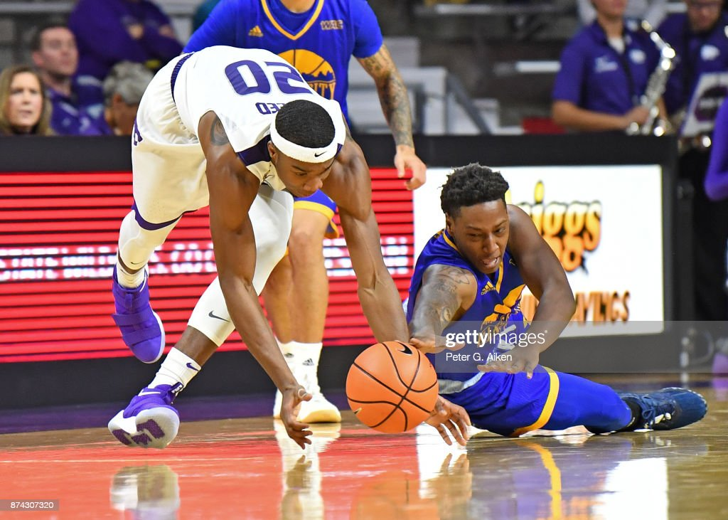 Forward Xavier Sneed #20 of the Kansas State Wildcats scrambles for a loose ball against guard Isaiah Ross #2 of the Missouri-Kansas City Kangaroos during the second half on November 14, 2017 at Bramlage Coliseum in Manhattan, Kansas.