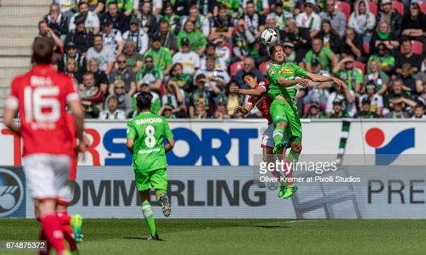 Forward Yoshinori Muto of FSV Mainz 05 and Midfielder Nico Schulz of Borussia Moenchengladbach at a headball during the 1 Bundesliga match between 1...