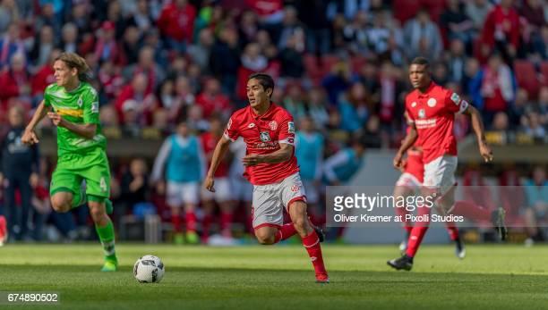 Forward Yoshinori Muto of FSV Mainz 05 in action during the 1 Bundesliga match between 1 FSV Mainz 05 and Borussia Moenchengladbach at the Opel Arena...