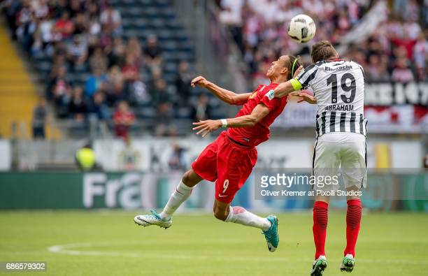 Forward Yussuf Yurary Poulsen of RB Leipzig and Defender David Abraham of Eintracht Frankfurt fighting for the ball at the Commerzbank Arena during...