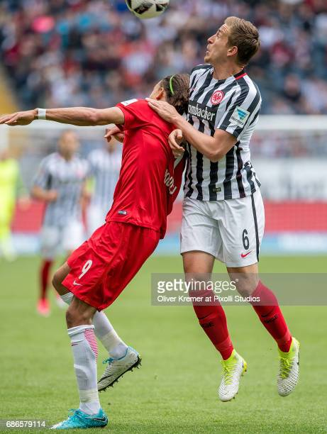 Forward Yussuf Yurary Poulsen of RB Leipzig and Defense Bastian Oczipka of Eintracht Frankfurt fighting for the ball at the Commerzbank Arena during...