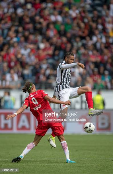 Forward Yussuf Yurary Poulsen of RB Leipzig and Defense Michael Hector of Eintracht Frankfurt fighting for the ball at the Commerzbank Arena during...