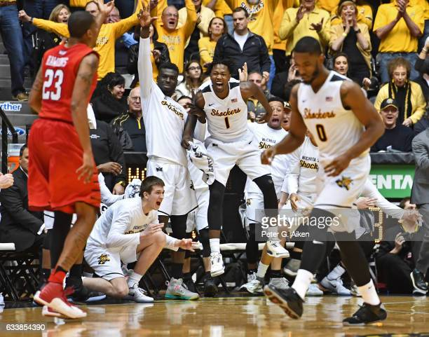 Forward Zach Brown and the bench celebrate after a score by Rashard Kelly of the Wichita State Shockers during the second half against the Illinois...