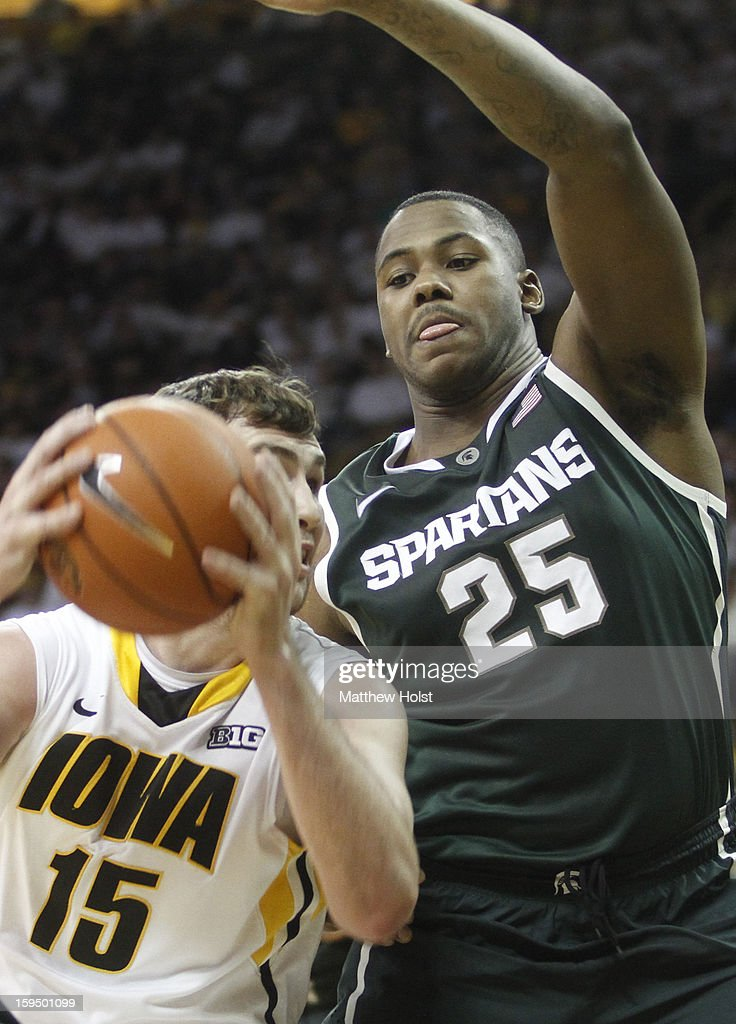 Forward Zach McCabe #15 of the Iowa Hawkeyes drives to the basket during the second half against center Derrick Nix #25 of the Michigan State Spartans on January 10, 2013 at Carver-Hawkeye Arena in Iowa City, Iowa. Michigan State won 62-59.