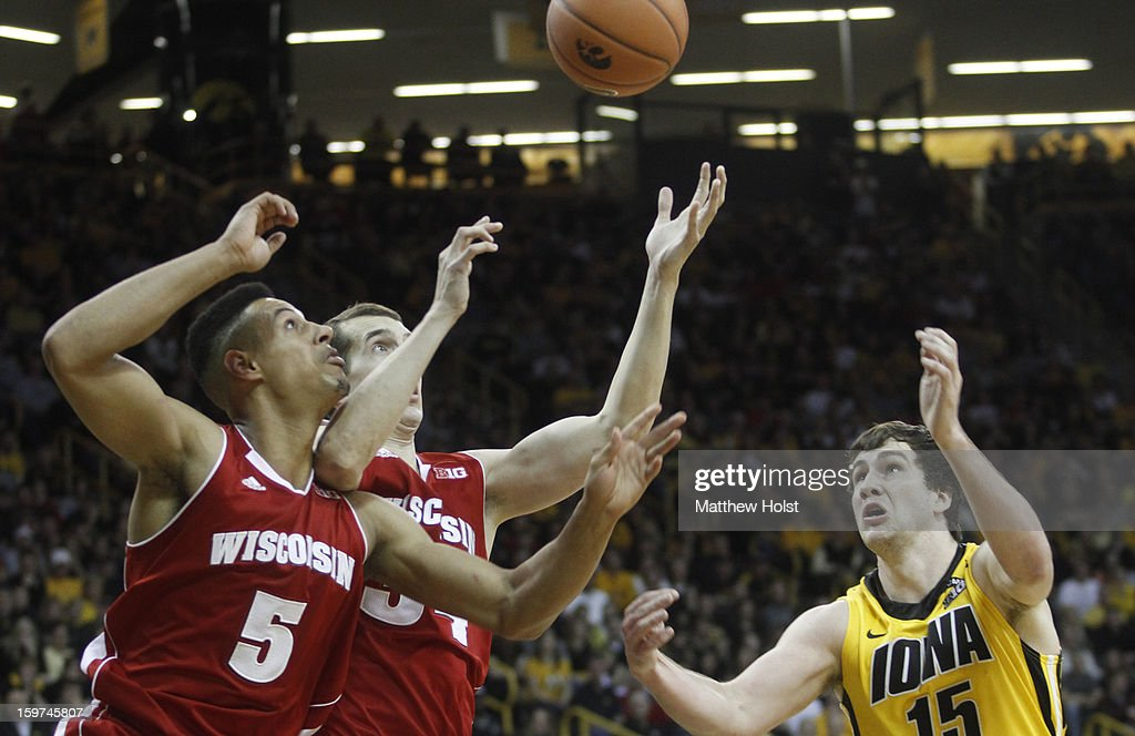Forward Zach McCabe #15 of the Iowa Hawkeyes fights for a rebound during the second half against guard Eric Evans #5 and forward Zach Bohannon #34 of the Wisconsin Badgers on January 19, 2013 at Carver-Hawkeye Arena in Iowa City, Iowa. Iowa won 70-66.