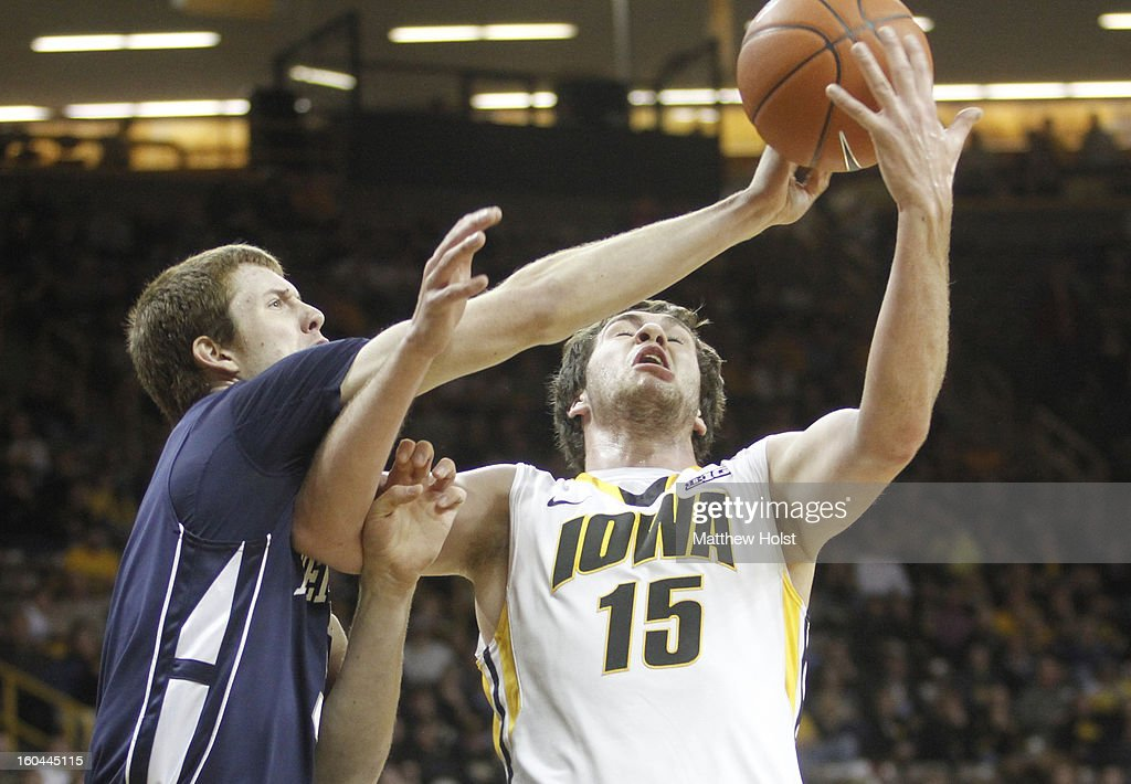 Forward Zach McCabe #15 of the Iowa Hawkeyes grabs a rebound during the first half in front of forward Donovan Jack #5 of the Penn State Nittany Lions on January 31, 2013 at Carver-Hawkeye Arena in Iowa City, Iowa.