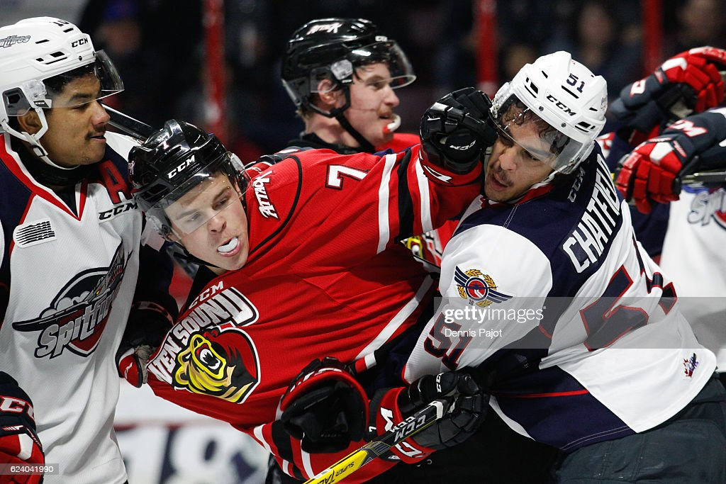 Forward Zachary Roberts #7 of the Owen Sound Attack battles in front of the net against defenceman Jalen Chatfield of the Windsor Spitfires on November 17, 2016 at the WFCU Centre in Windsor, Ontario, Canada.
