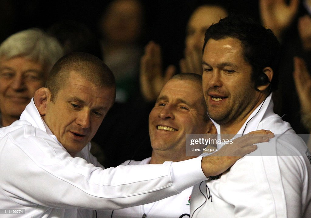 Forwards coach <a gi-track='captionPersonalityLinkClicked' href=/galleries/search?phrase=Graham+Rowntree&family=editorial&specificpeople=215047 ng-click='$event.stopPropagation()'>Graham Rowntree</a>, <a gi-track='captionPersonalityLinkClicked' href=/galleries/search?phrase=Stuart+Lancaster&family=editorial&specificpeople=2263180 ng-click='$event.stopPropagation()'>Stuart Lancaster</a>, head coach of England and England Backs Coach <a gi-track='captionPersonalityLinkClicked' href=/galleries/search?phrase=Andy+Farrell+-+Rugby+Coach&family=editorial&specificpeople=234823 ng-click='$event.stopPropagation()'>Andy Farrell</a> celebrate at the final whistle during the RBS 6 Nations match between England and Ireland at Twickenham Stadium on March 17, 2012 in London, England.