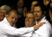Forwards coach Graham Rowntree Stuart Lancaster head coach of England and England Backs Coach Andy Farrell celebrate at the final whistle during the...
