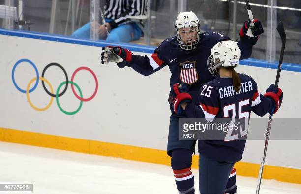 US forwards Hilary Knight and Alex Carpenter celebrate Carpenter's goal against Finland during the second period in a women's hockey game at the...