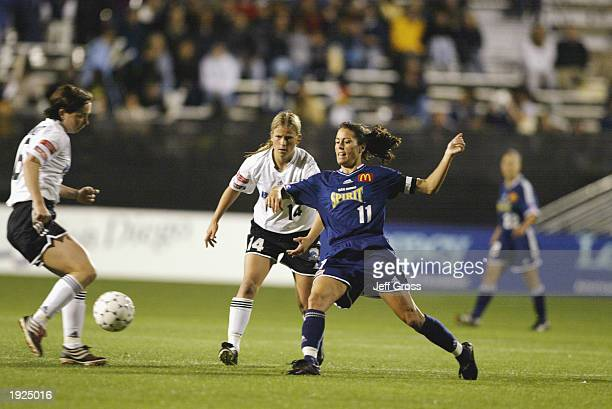 Forwards Maren Meinert and Dagny Mellgren of the Boston Breakers battle for the ball with midfielder Julie Foudy of the San Diego Spirit during their...