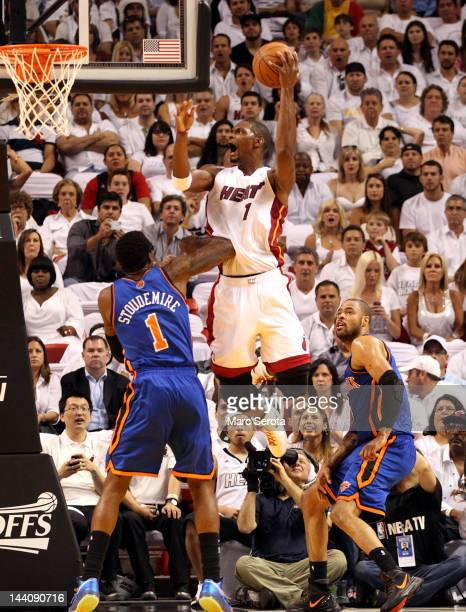 Forwards Tyson Chandler and Amar'e Stoudemire of the New York Knicks defend Forward Chris Bosh of the Miami Heat in Game Five of the Eastern...