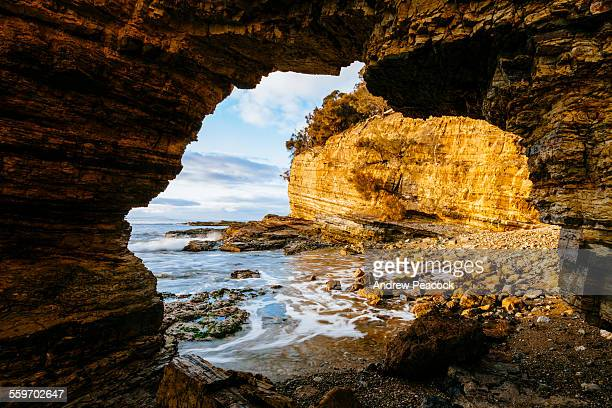 Fossil Cove natural rock arch at sunrise