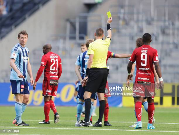 Fouad Bachirou of Ostersunds FK is shown a yellow card by Magnus Lindgren referee during the Allsvenskan match between Djurgardens IF and Ostersunds...