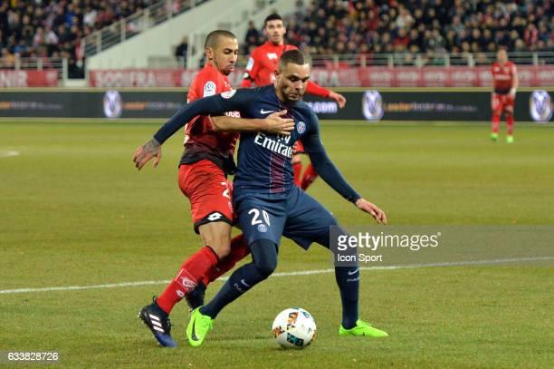 Fouad Chafik of Dijon and Layvin Kurzawa of PSG during the Ligue 1 match between Dijon DCO and Paris Saint Germain at Stade Gaston Gerard on February...