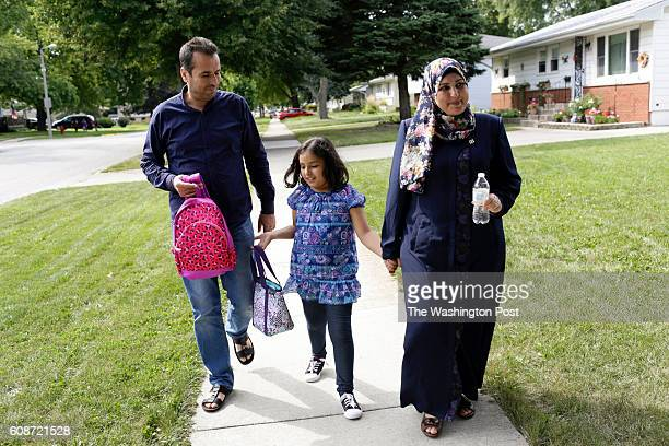 Fouad Haj Ali from left walks his daughter Boshra home after school with his wife Rabia on Wednesday September 14 2016 in Aurora IL