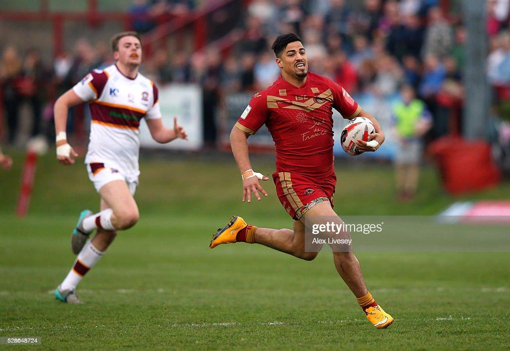 Fouad Yaha of Catalan Dragons breaks away to score the opening try during the Ladbrokes Challenge Cup Sixth Round match between Batley Bulldogs and Catalan Dragons at the Fox's Biscuits Stadium on May 06, 2016 in Batley, England.