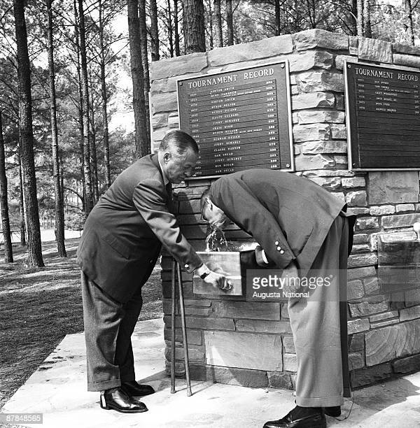 Fouder Bobby Jones assists Clifford Roberts with the drinking fountain on the 15th hole during the 1959 Masters Tournament at Augusta National Golf...