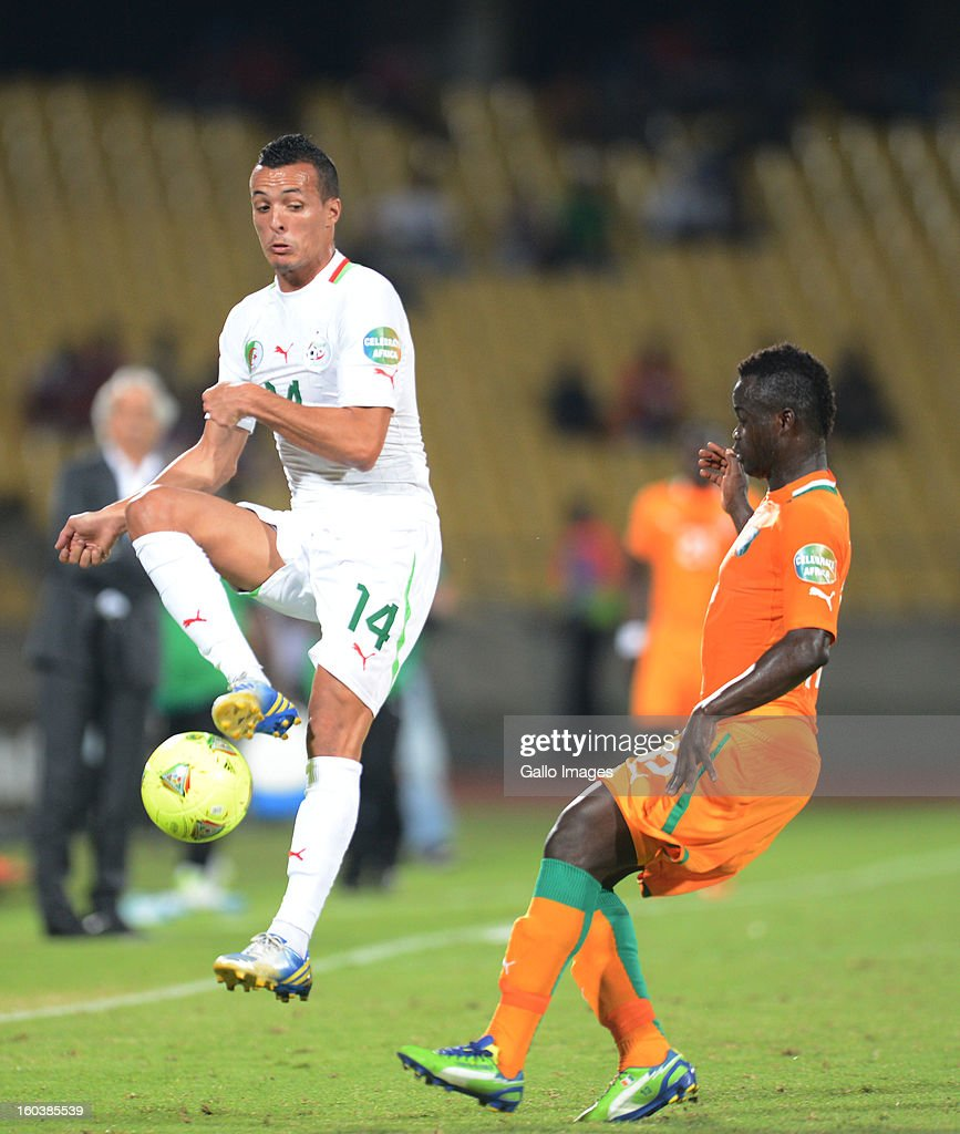 Foued Kadir of Algeria and Max Gradel of Ivory Coast during the 2013 African Cup of Nations match between Algeria and Ivory Coast at Royal Bafokeng Stadium on January 30, 2013 in Rustenburg, South Africa.