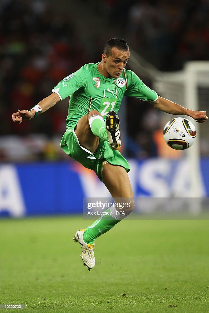 <a gi-track='captionPersonalityLinkClicked' href=/galleries/search?phrase=Foued+Kadir&family=editorial&specificpeople=4520875 ng-click='$event.stopPropagation()'>Foued Kadir</a> of Algeria controls the ball during the 2010 FIFA World Cup South Africa Group C match between England and Algeria at Green Point Stadium on June 18, 2010 in Cape Town, South Africa.