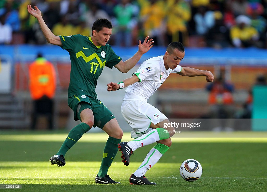 Foued Kadir of Algeria (R) is under pressure from Andraz Kirm of Slovenia during the 2010 FIFA World Cup South Africa Group C match between Algeria and Slovenia at the Peter Mokaba Stadium on June 13, 2010 in Polokwane, South Africa.