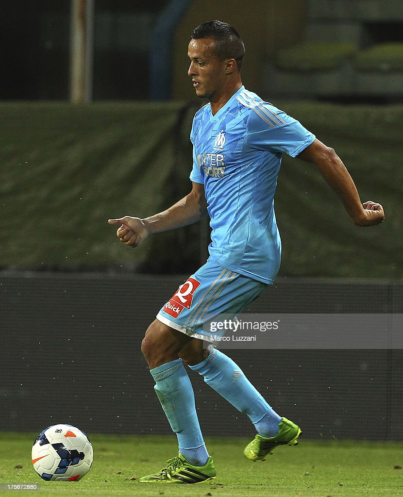 <a gi-track='captionPersonalityLinkClicked' href=/galleries/search?phrase=Foued+Kadir&family=editorial&specificpeople=4520875 ng-click='$event.stopPropagation()'>Foued Kadir</a> of Olympique de Marseille in action during the pre-season friendly match between Parma FC and Olympique de Marseille at Stadio Ennio Tardini on July 31, 2013 in Parma, Italy.