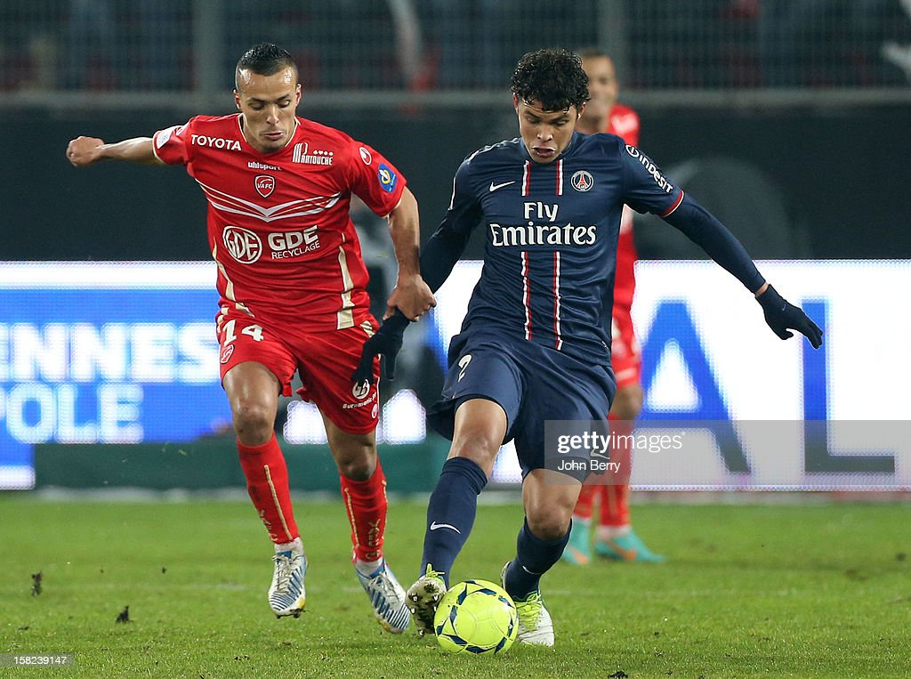 Foued Kadir of VAFC tries to steal the ball from Thiago Silva of PSG during the French Ligue 1 match between Valenciennes FC and Paris Saint-Germain FC at the Stade du Hainaut on December 11, 2012 in Valenciennes, France.