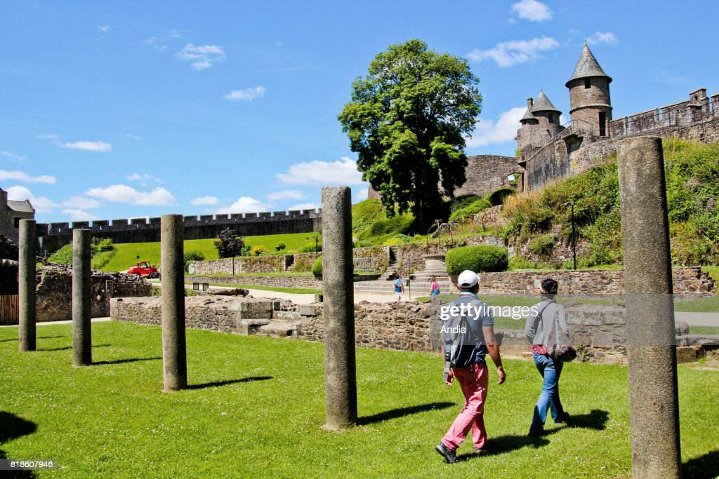 Fougeres (Brittany, north-western France): the fortified castle, monument registered as a National Historic Landmark (French 'Monument Historique'). Ruins of the seignioral living quarters with the tower Tour de Guibe in the background.