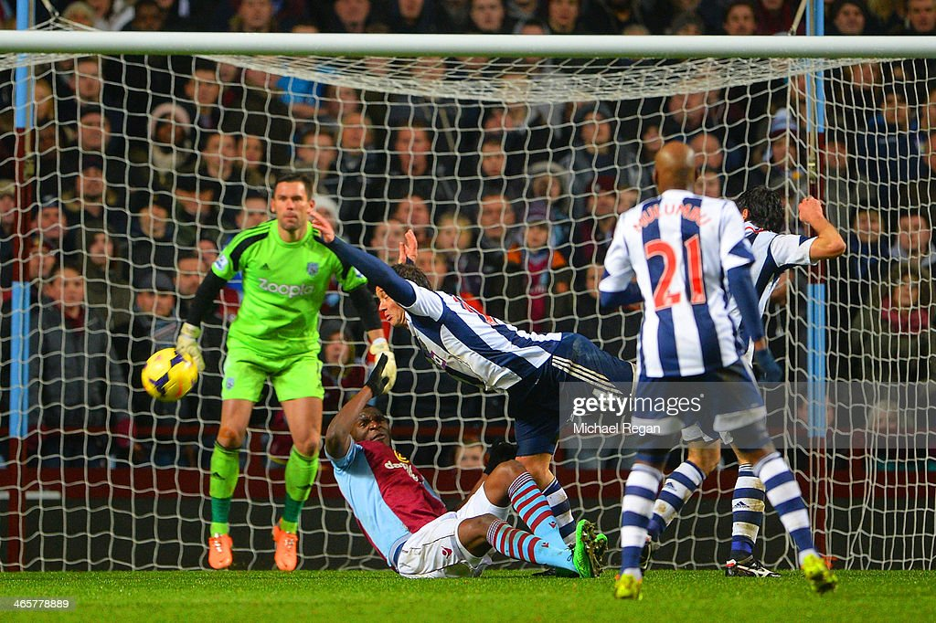 Foul by Diego Lugano of West Brom on Christian Benteke of Aston Villa to concede a penalty during the Barclays Premier League match between Aston...