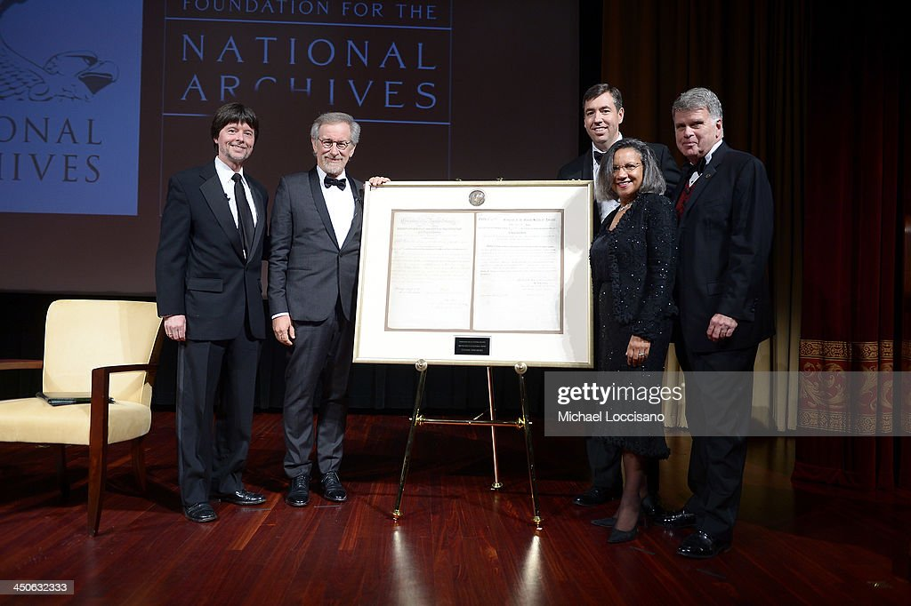 Foundation for the National Archives Board Vice President and Gala Chair <a gi-track='captionPersonalityLinkClicked' href=/galleries/search?phrase=Ken+Burns&family=editorial&specificpeople=220451 ng-click='$event.stopPropagation()'>Ken Burns</a>, filmmaker and honoree <a gi-track='captionPersonalityLinkClicked' href=/galleries/search?phrase=Steven+Spielberg&family=editorial&specificpeople=202022 ng-click='$event.stopPropagation()'>Steven Spielberg</a>, Executive Director of the Foundation for the National Archives Patrick Madden, Foundation for the National Archives Chair and President A'Lelia Bundles, and Archivist of the United States The Honorable David S. Ferriero pose onstage with facsimile versions of the 'two 13th Amendments' at the Foundation for the National Archives 2013 Records of Achievement award ceremony and gala in honor of <a gi-track='captionPersonalityLinkClicked' href=/galleries/search?phrase=Steven+Spielberg&family=editorial&specificpeople=202022 ng-click='$event.stopPropagation()'>Steven Spielberg</a> on November 19, 2013 in Washington, D.C.
