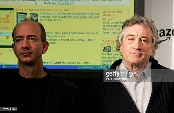 Founder and CEO of Amazoncom Jeff Bezos and Tribeca Film Festival founder Robert De Niro listen to speakers during the Tribeca Film Festival...