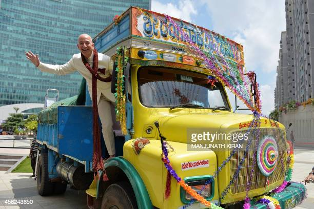 US founder and CEO of Amazoncom Jeff Bezos poses on a lorry after handing over a two billion dollar cheque to Indian Vice President and Country...