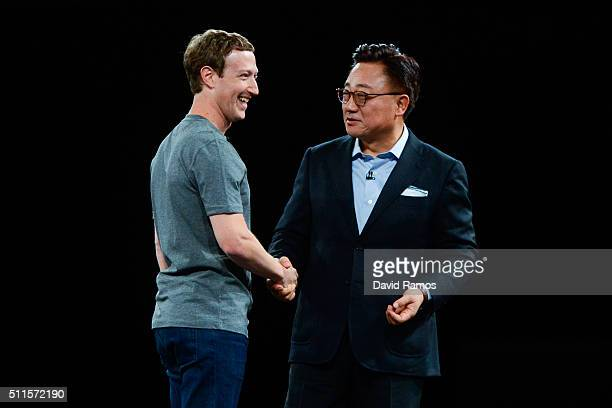 Founder and CEO of Facebook Mark Zuckerberg and President of Mobile Communications Business of Samsung DJ Koh shake hands during the presentation of...