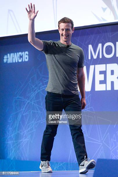 Founder and CEO of Facebook Mark Zuckerberg waves as he arrives for a keynote conference on the opening day of the World Mobile Congress at the Fira...