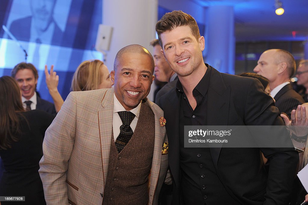 Founder and CEO of KWL Enterprises Kevin Liles and singer Robin Thicke attend the 2013 GQ Gentlemen's Ball presented by BMW i, Movado, and Nautica at IAC Building on October 23, 2013 in New York City.