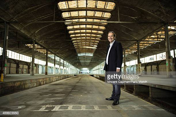Founder and CEO of telecoms company Iliad Free Group Xavier Niel is photographed for Paris Match at La Halle Freyssinet a former railway factory...