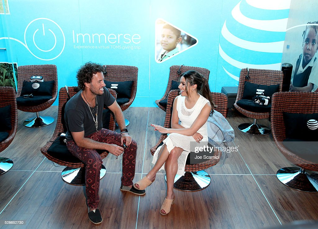 Founder and Chief Shoe Giver Blake Mycoskie and Actress Lea Michele attend the AT&T and TOMS 10 Year Celebration Shoebox at Santa Monica Pier on May 6, 2016 in Santa Monica, California.