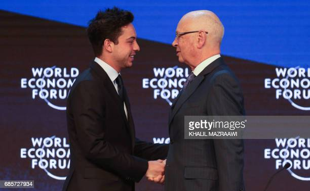 Founder and Executive Chairperson of the World Economic Forum Klaus Schwab shakes hands with Jordan's Crown Prince Hussein the son of King Abdullah...