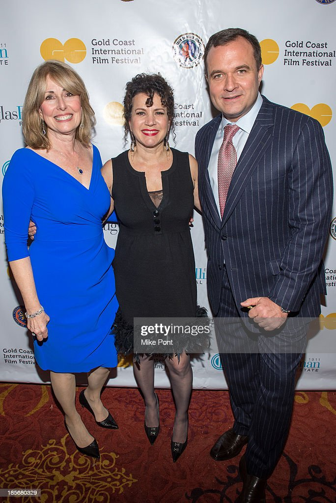 Founder and Executive Director of the Gold Coast International Film Festival Regina Gil, Actress/Comedian <a gi-track='captionPersonalityLinkClicked' href=/galleries/search?phrase=Susie+Essman&family=editorial&specificpeople=666342 ng-click='$event.stopPropagation()'>Susie Essman</a> and Journalist Greg Kelly attend the annual benefit gala during the Third Annual Gold Coast International Film Festival at on October 23, 2013 in Port Washington, New York.