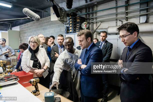 Founder and Leader of the political movement 'En Marche ' and candidate for the 2017 French Presidential Election Emmanuel Macron visits APF...