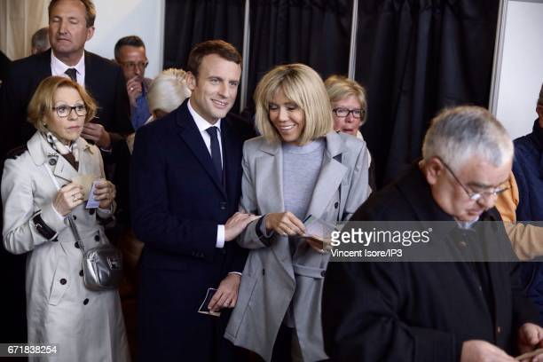 Founder and Leader of the political movement 'En Marche ' and presidential candidate Emmanuel Macron and his wife Brigitte Trogneux vote in the first...