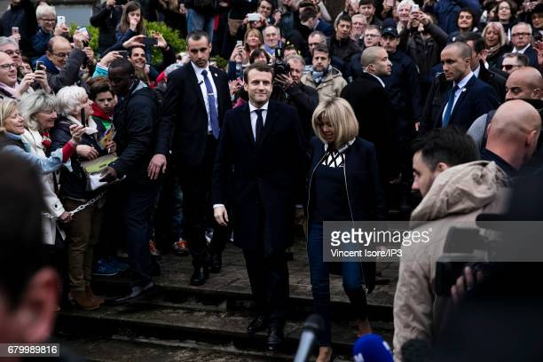 Founder and Leader of the political movement 'En Marche ' and presidential candidate Emmanuel Macron and his wife Brigitte Trogneux go to vote for...