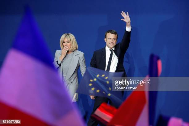 Founder and Leader of the political movement 'En Marche ' Emmanuel Macron flanked by his wife Brigitte Trogneux speaks after projected results...