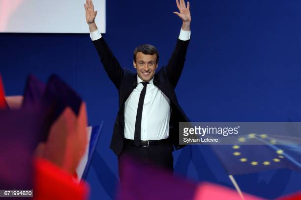 Founder and Leader of the political movement 'En Marche ' Emmanuel Macron greets supporters after winning the most votes in the first round of the...