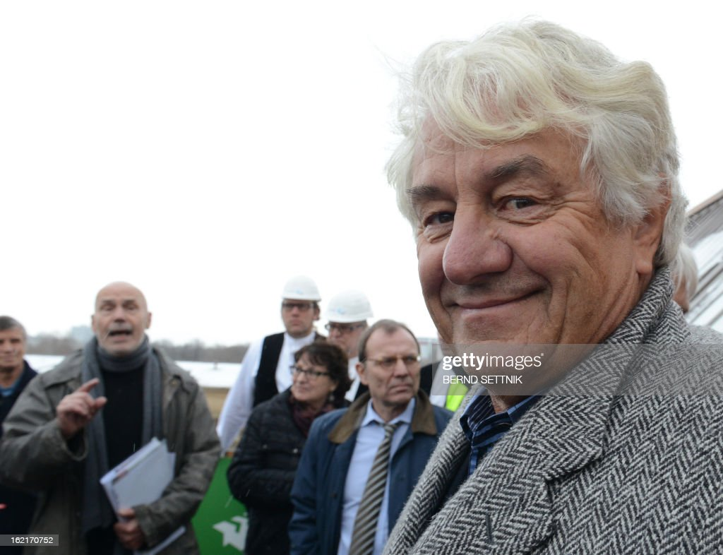 SAPfounder and patron Hasso Plattner stands on the roof of the new parliament building in Potsdam,eastern Germany, on February 19, 2013. The Giving Pledge announced on February 19, 2013 that Plattner has joint the initiative by Warren Buffet an Bill Gates to donate a majority of their wealth for philanthropy and charity.