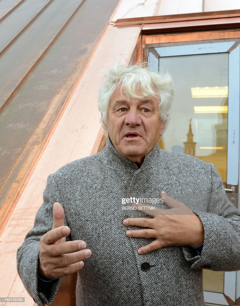 SAP founder and patron Hasso Plattner stands on the roof of the new parliament building in Potsdam, eastern Germany, on February 19, 2013. The Giving Pledge announced on February 19, 2013 that Plattner has joint the initiative by Warren Buffet an Bill Gates to donate a majority of their wealth for philanthropy and charity.