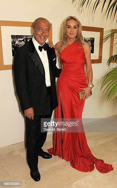 Founder and President of de Grisogono Fawaz Gruosi and actress Sharon Stone attend a cocktail reception at the de Grisogono Party during the 66th...