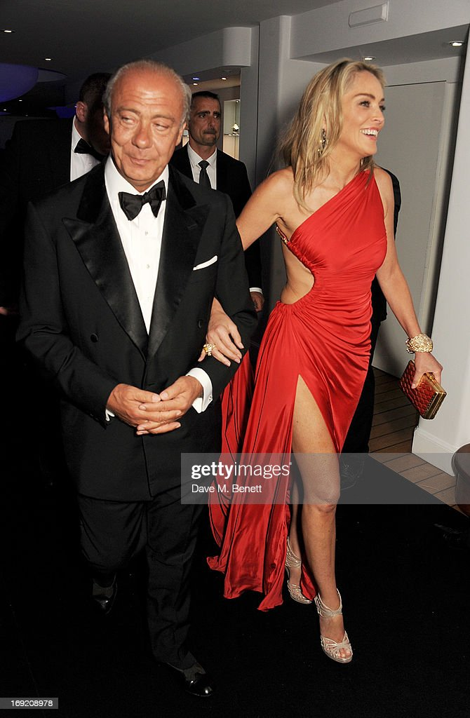 Founder and President of de Grisogono <a gi-track='captionPersonalityLinkClicked' href=/galleries/search?phrase=Fawaz+Gruosi&family=editorial&specificpeople=206588 ng-click='$event.stopPropagation()'>Fawaz Gruosi</a> (L) and actress <a gi-track='captionPersonalityLinkClicked' href=/galleries/search?phrase=Sharon+Stone&family=editorial&specificpeople=156409 ng-click='$event.stopPropagation()'>Sharon Stone</a> attend the de Grisogono Party during the 66th International Cannes Film Festival at Hotel Du Cap on May 21, 2013 in Antibes, France.