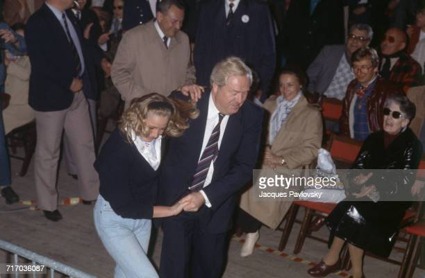 Founder and president of the French Front National party JeanMarie Le Pen dances with his daughter Marine at a a political convention in Paris 13th...